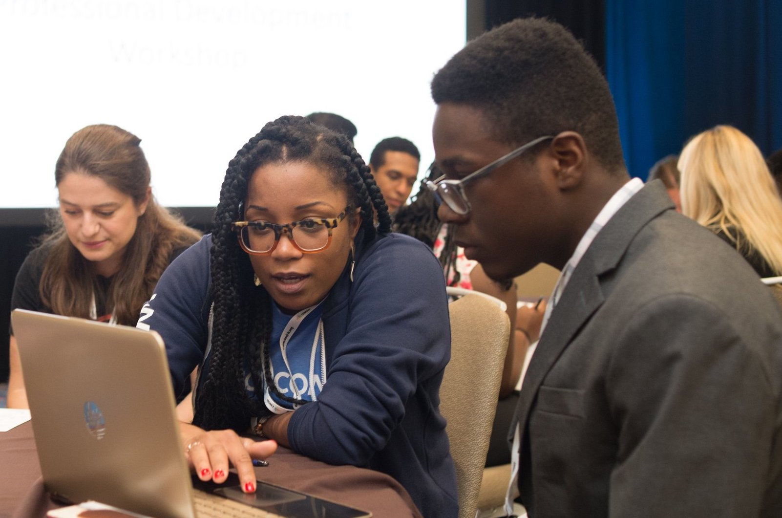 Two students working on a laptop together at the 2019 Tapia Student Professional Development Workshop